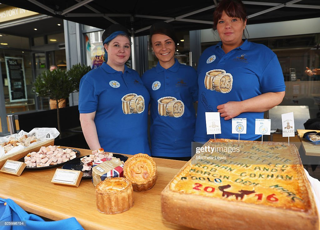 Jamie-Lee Gourlay, Leighanne Butlin and Hannah Guest of Walkers are pictured with Walkers 'special pies' during a Leicester Backing the Blues Campaign in support of Leicester City on April 29, 2016 in Leicester, England.