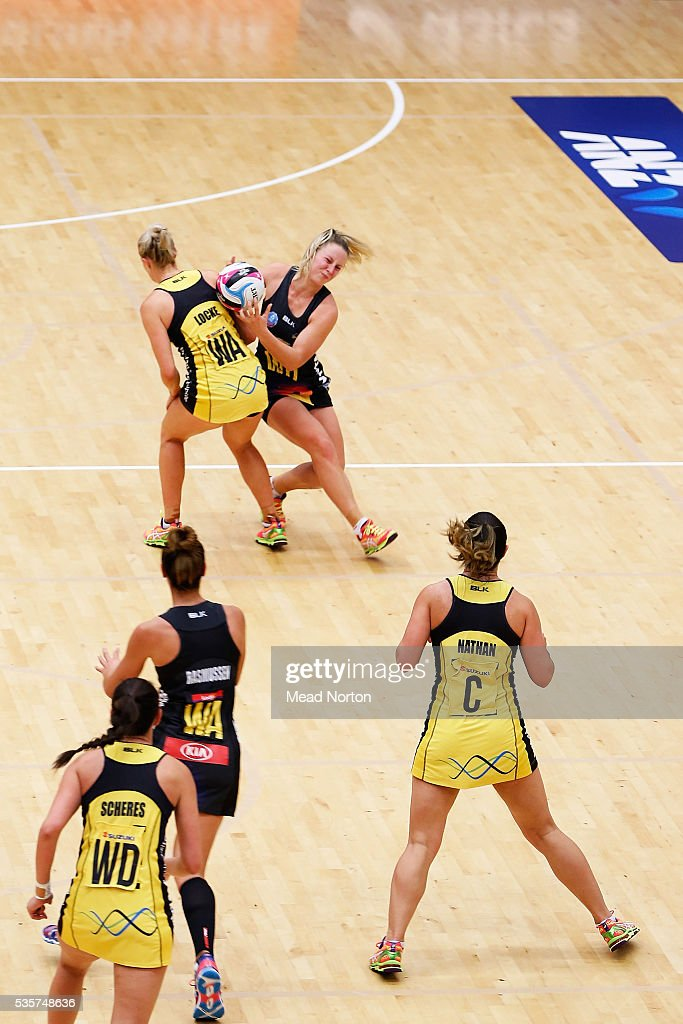 Jamie-Lee Price fighting off Chelsea Locke for the ball during the round nine ANZ Championship match between the Magic and the Pulse at ASB Baypark Stadium on May 30, 2016 in Mount Maunganui, New Zealand.