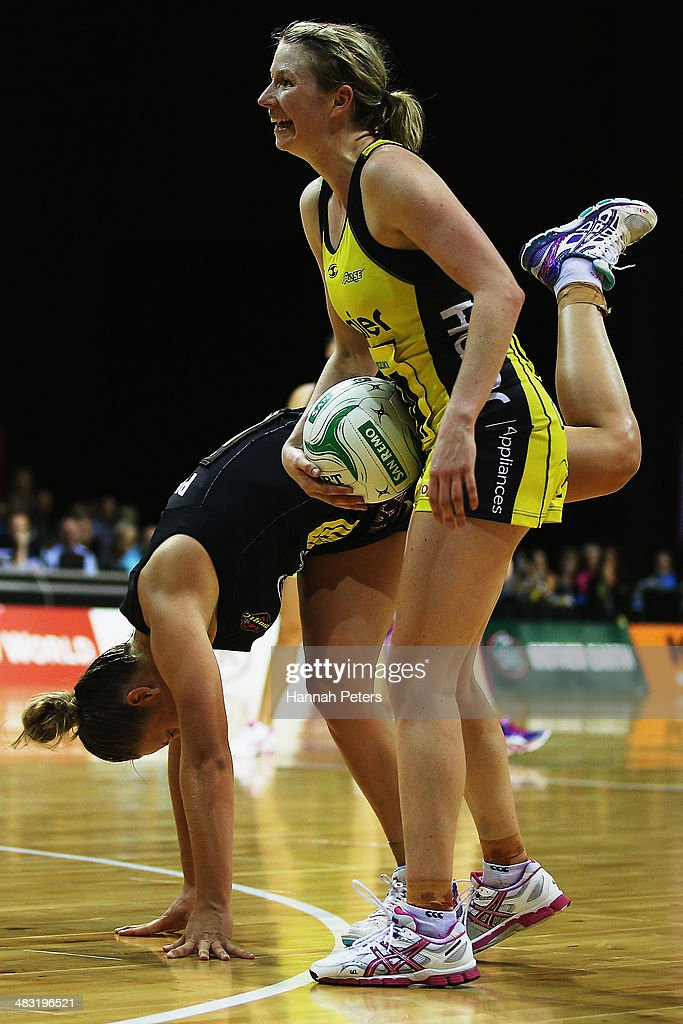 Jamie-Lee Price of the Magice loses her footing as Camilla Lees of the Pulse secures possession during the ANZ Championship match between the Magic and the Pulse on April 7, 2014 in Auckland, New Zealand.