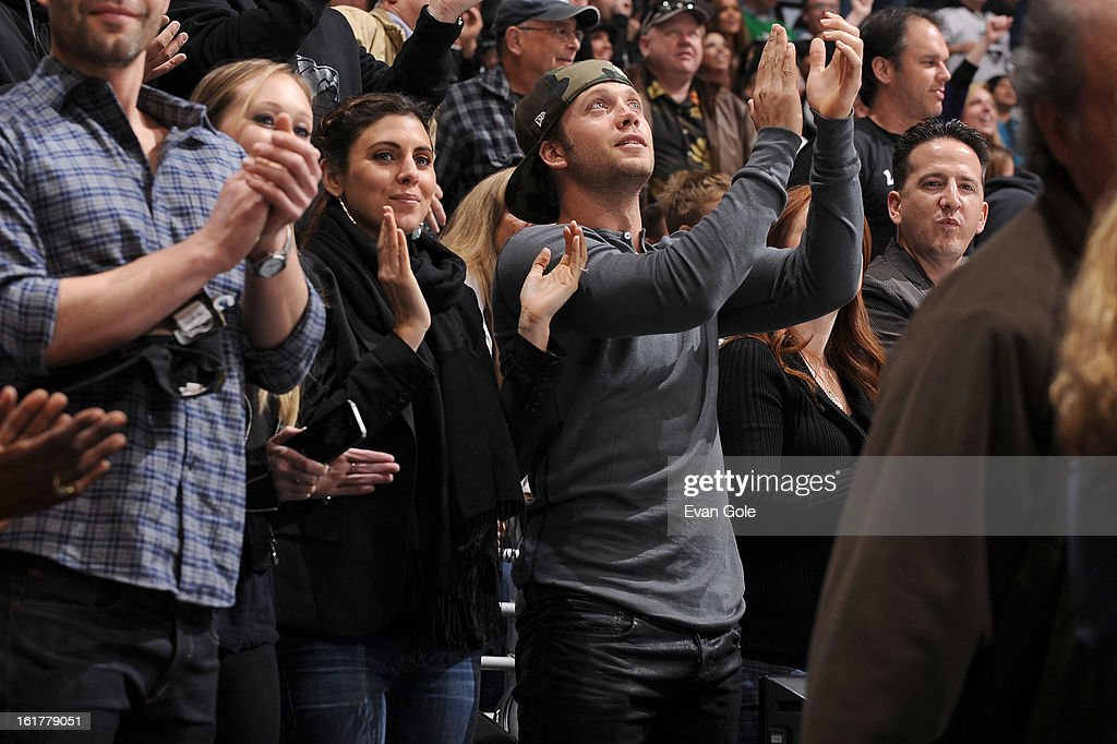 Jamie-Lynn Sigler and Cutter Dykstra look on as the Los Angeles Kings defeat the Columbus Blue Jackets at Staples Center on February 15, 2013 in Los Angeles, California.