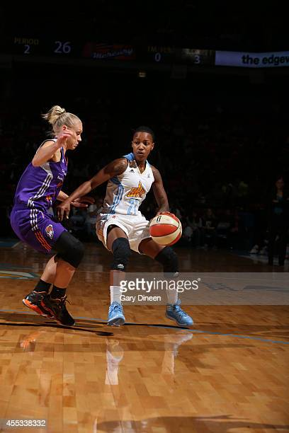 Jamierra Faulkner of the Chicago Sky drives against the Phoenix Mercury in Game Three of the 2014 WNBA Finals on September 12 2014 at the UIC...