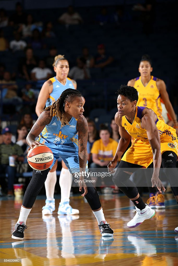 Jamierra Faulkner #21 of the Chicago Sky handles the ball during the game against <a gi-track='captionPersonalityLinkClicked' href=/galleries/search?phrase=Alana+Beard&family=editorial&specificpeople=210691 ng-click='$event.stopPropagation()'>Alana Beard</a> #0 of the Los Angeles Sparks on May 24, 2016 at the Allstate Arena in Chicago, Illinois.