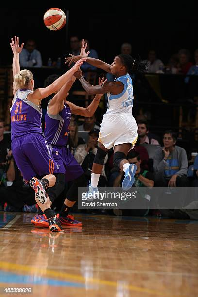 Jamierra Faulkner of the Chicago Sky passes against Erin Phillips of the Phoenix Mercury in Game Three of the 2014 WNBA Finals on September 12 2014...