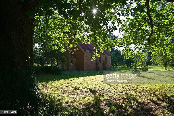 A tiny colonial church amongst Oak Trees on a sunny Christmas Day.