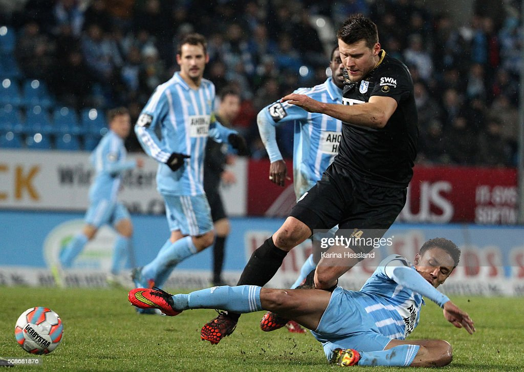 Jamil Raphael Dem of Chemnitz challenges Niklas Brandt of Magdeburg during the Third League match between Chemnitzer FC and 1.FC Magdeburg at Stadion an der Gellertstrasse on February 05, 2016 in Chemnitz, Germany.