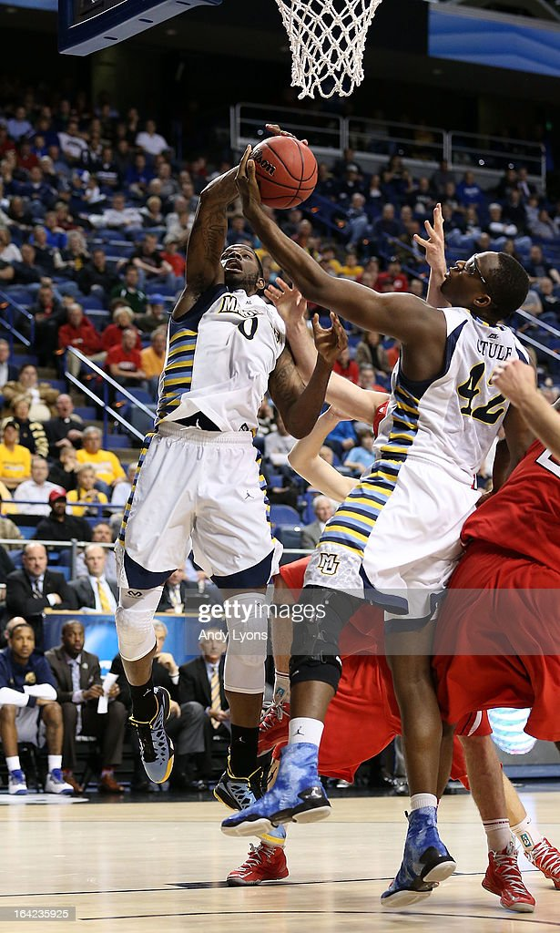 Jamil Wilson #0 and Chris Otule #42 of the Marquette Golden Eagles battle for a rebound against the Davidson Wildcats in the second half during the second round of the 2013 NCAA Men's Basketball Tournament at the Rupp Arena on March 21, 2013 in Lexington, Kentucky.