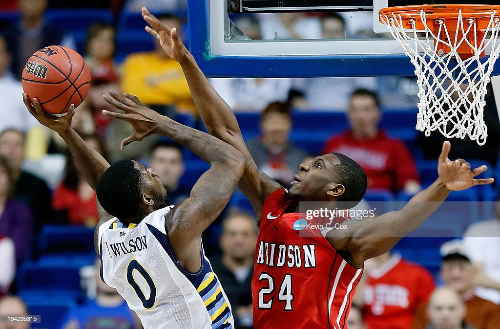 Jamil Wilson #0 of the Marquette Golden Eagles shoots against De'Mon Brooks #24 of the Davidson Wildcats in the second half during the second round of the 2013 NCAA Men's Basketball Tournament at the Rupp Arena on March 21, 2013 in Lexington, Kentucky.
