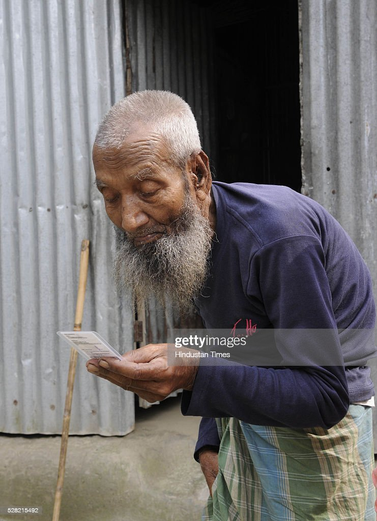 Jamir Khan 105-year-old resident of Mashaldanga village, Chhitmahal is excited about casting vote for the first time tomorrow showing his voter i card on May 4, 2015 in Coochbehar, India. More than 9,800 of the 10,100 eligible voters in former Bangladeshi enclaves of West Bengals Cooch Behar have enrolled for the voter list, signalling exceptional enthusiasm among the people who became Indian citizens less than nine months ago. These people have lived in a virtual no-mans land for 68 years because of a complex territorial division, which created enclaves or islands of foreign territory inside each country along the Indo-Bangladesh border. The two countries agreed in 2015 to swap the almost 200 enclaves located in one country but officially belonging to the other.