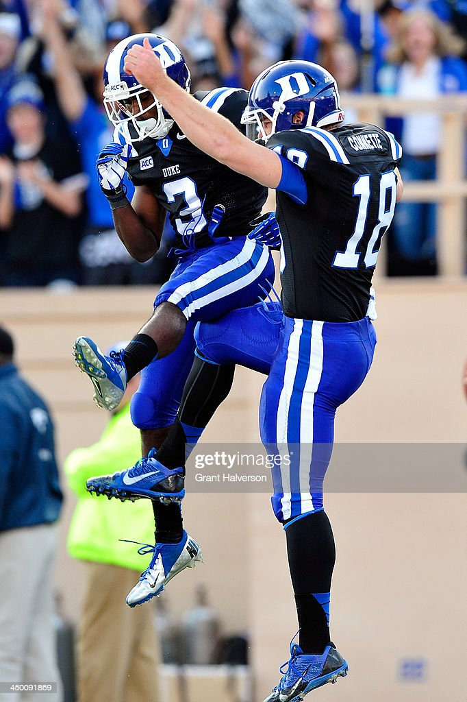 Jamison Crowder #3 and Brandon Connette #18 of the Duke Blue Devils celebrate after Connette's touchdown against the Miami Hurricanes during play at Wallace Wade Stadium on November 16, 2013 in Durham, North Carolina.