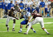 Jamison Crowder of the Duke Blue Devils is tackled by Howard Matthews and Deshazor Everett of the Texas AM Aggies during the ChickFilA Bowl at the...