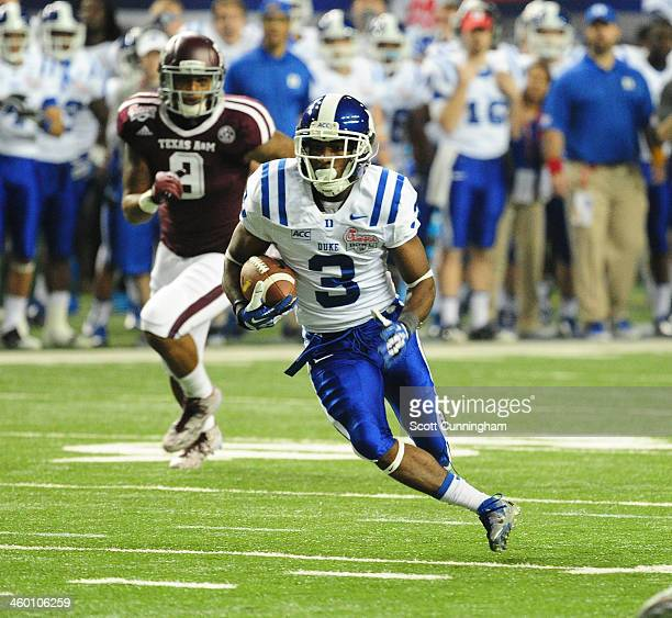 Jamison Crowder of the Duke Blue Devils runs with a catch against the Texas AM Aggies during the ChickFilA Bowl at the Georgia Dome on December 31...