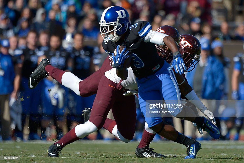 <a gi-track='captionPersonalityLinkClicked' href=/galleries/search?phrase=Jamison+Crowder&family=editorial&specificpeople=8230117 ng-click='$event.stopPropagation()'>Jamison Crowder</a> #3 of the Duke Blue Devils spins out of a tackle during their game against the Virginia Tech Hokies at Wallace Wade Stadium Stadium on November 15, 2014 in Chapel Hill, North Carolina.