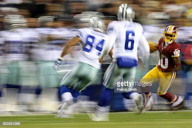 Jamison Crowder of the Washington Redskins carries the ball against James Hanna of the Dallas Cowboys and punter Chris Jones of the Dallas Cowboys in...