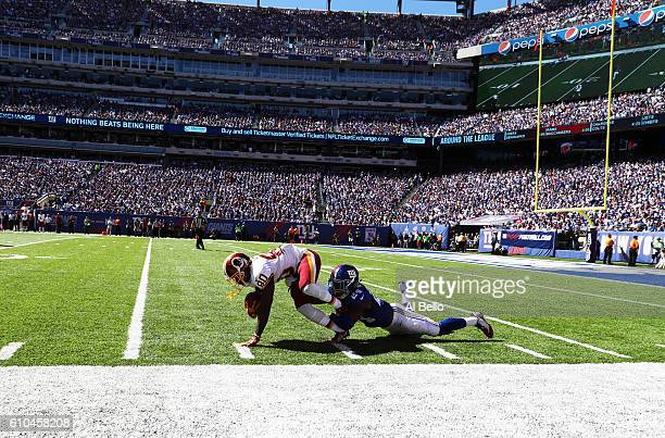 Jamison Crowder of the Washington Redskins escapes a tackle by Eli Apple of the New York Giants on a punt return during their game at MetLife Stadium...