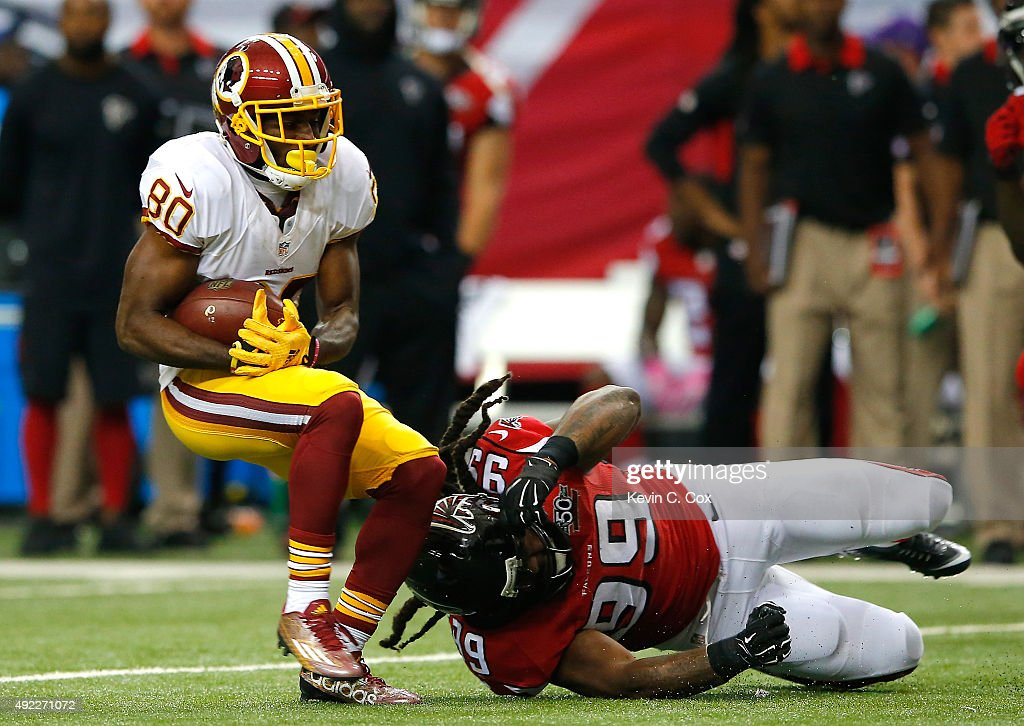 <a gi-track='captionPersonalityLinkClicked' href=/galleries/search?phrase=Jamison+Crowder&family=editorial&specificpeople=8230117 ng-click='$event.stopPropagation()'>Jamison Crowder</a> #80 of the Washington Redskins pulls in this reception against <a gi-track='captionPersonalityLinkClicked' href=/galleries/search?phrase=Adrian+Clayborn&family=editorial&specificpeople=4483599 ng-click='$event.stopPropagation()'>Adrian Clayborn</a> #99 of the Atlanta Falcons at Georgia Dome on October 11, 2015 in Atlanta, Georgia.