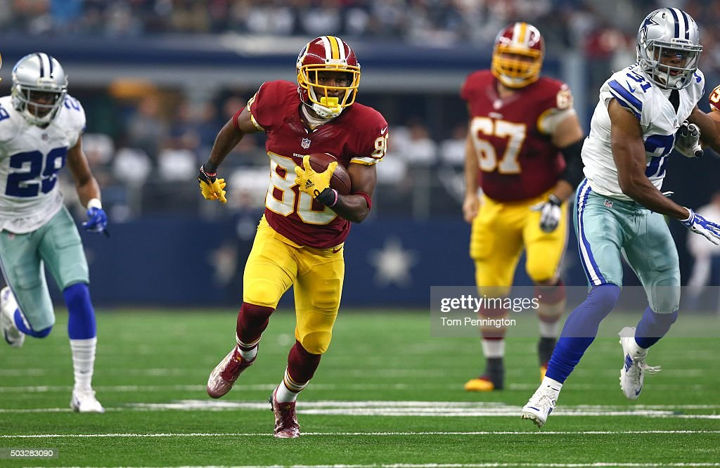 <a gi-track='captionPersonalityLinkClicked' href=/galleries/search?phrase=Jamison+Crowder&family=editorial&specificpeople=8230117 ng-click='$event.stopPropagation()'>Jamison Crowder</a> #80 of the Washington Redskins runs between Deji Olatoye #29 and <a gi-track='captionPersonalityLinkClicked' href=/galleries/search?phrase=Byron+Jones+-+American+Football+Cornerback&family=editorial&specificpeople=13966302 ng-click='$event.stopPropagation()'>Byron Jones</a> #31 of the Dallas Cowboys during the first half at AT&T Stadium on January 3, 2016 in Arlington, Texas.