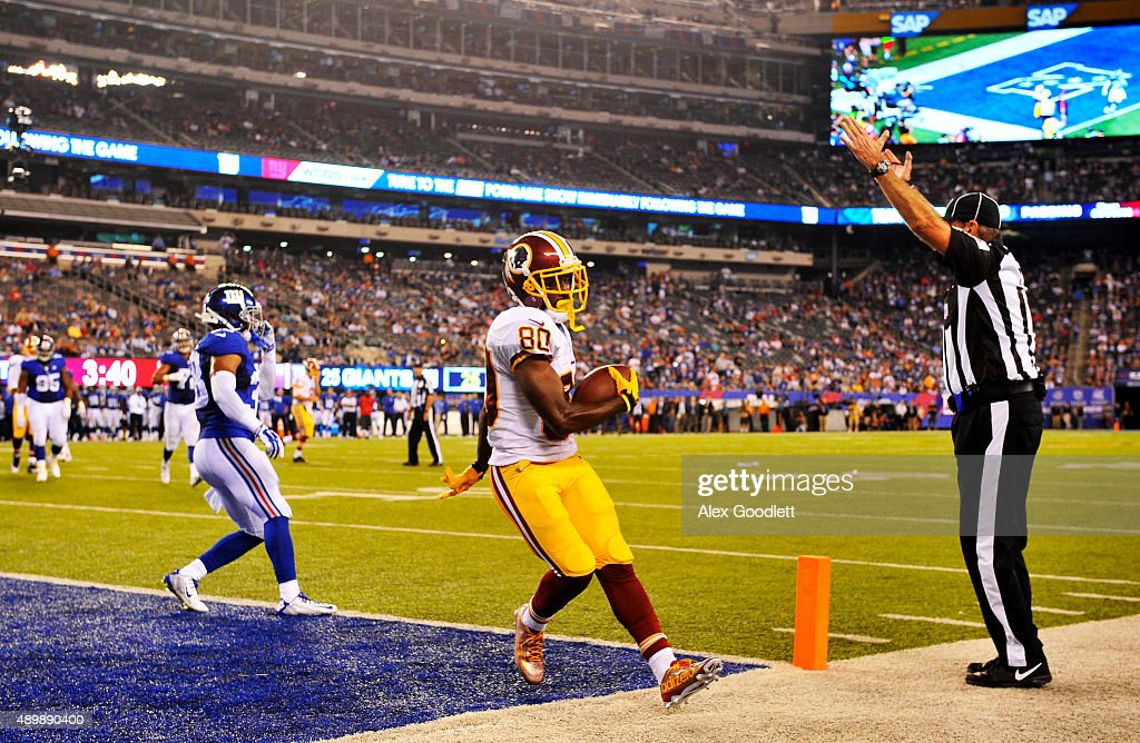 <a gi-track='captionPersonalityLinkClicked' href=/galleries/search?phrase=Jamison+Crowder&family=editorial&specificpeople=8230117 ng-click='$event.stopPropagation()'>Jamison Crowder</a> #80 of the Washington Redskins scores a touchdown in the fourth quarter as <a gi-track='captionPersonalityLinkClicked' href=/galleries/search?phrase=Trumaine+McBride&family=editorial&specificpeople=3972074 ng-click='$event.stopPropagation()'>Trumaine McBride</a> #38 of the New York Giants defends at MetLife Stadium on September 24, 2015 in East Rutherford, New Jersey.