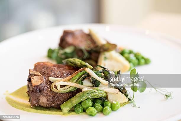 Jamison farm lamb porterhouse english peas artichoke zucchini hummus thyme jus at Vidalia