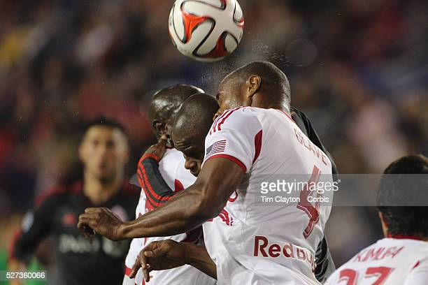 Jamison Olave New York Red Bulls and Jackson Toronto FC clash heads while challenging for a ball during the New York Red Bulls Vs Toronto FC Major...