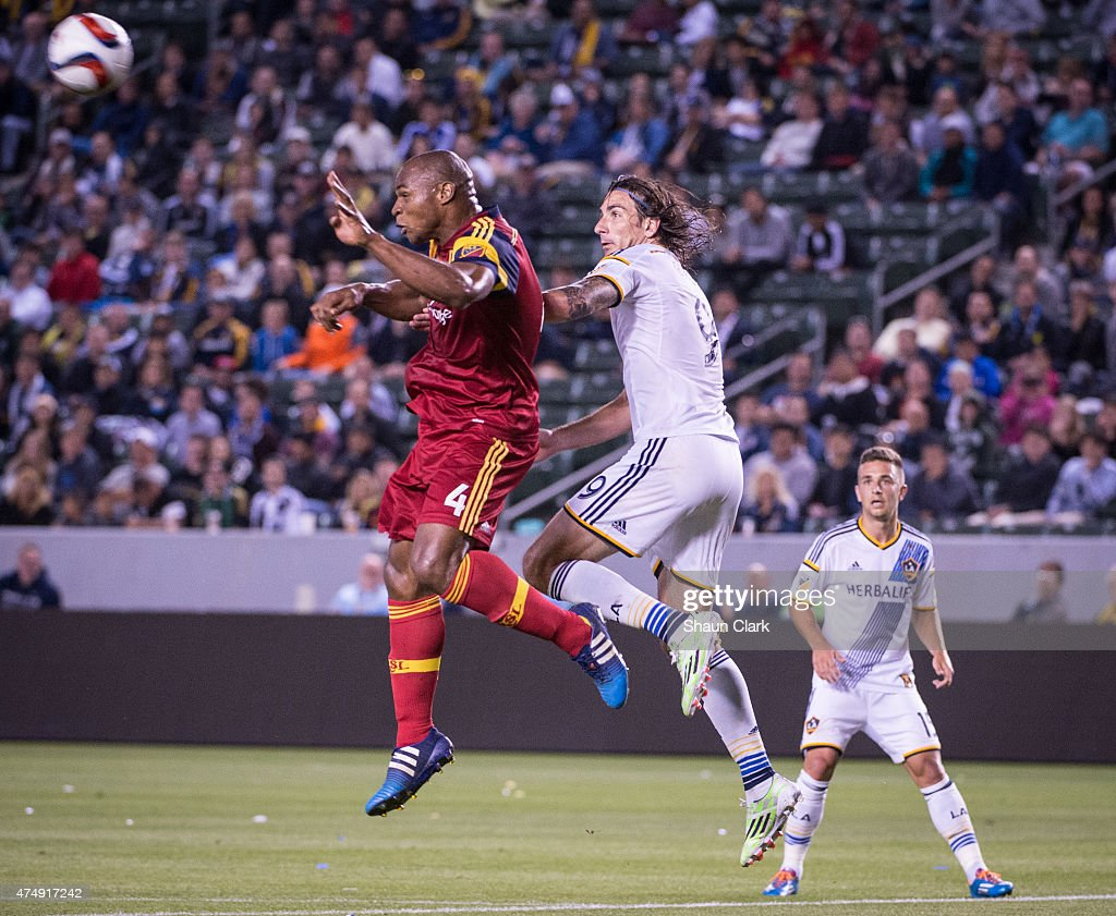 <a gi-track='captionPersonalityLinkClicked' href=/galleries/search?phrase=Jamison+Olave&family=editorial&specificpeople=680313 ng-click='$event.stopPropagation()'>Jamison Olave</a> (4) of Real Salt Lake defends a cross intended for <a gi-track='captionPersonalityLinkClicked' href=/galleries/search?phrase=Alan+Gordon+-+Soccer+Player&family=editorial&specificpeople=11667134 ng-click='$event.stopPropagation()'>Alan Gordon</a> (9) of Los Angeles Galaxy during Los Angeles Galaxy's match against Real Salt Lake at the Stubhub Center on May 27, 2015 in Carson, California. The LA Galaxy won the match 1-0.