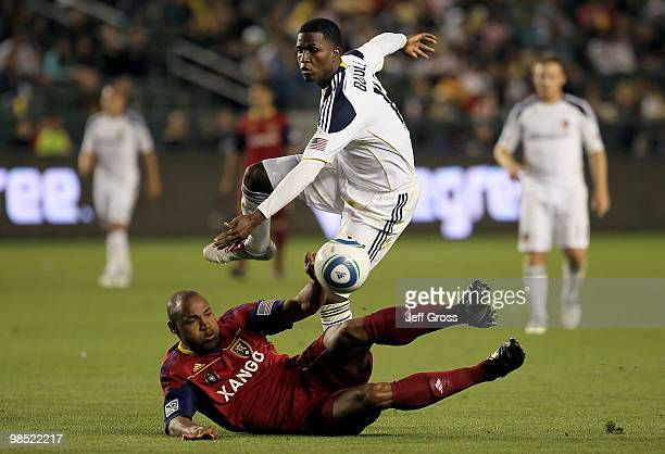 Jamison Olave of Real Salt Lake tackles Edson Buddle of the Los Angeles Galaxy in the second half at the Home Depot Center on April 17 2010 in Carson...