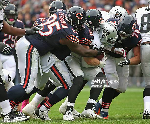 Jamize Olawale of the Oakland Raiders is gangtackled by Ego Ferguson Shea McClellin and Mitch Unrein of the Chicago Bears at Soldier Field on October...