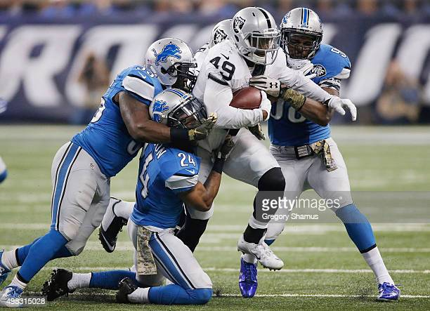 Jamize Olawale of the Oakland Raiders tries to break the tackle by the Detroit Lions in the second quarter at Ford Field on November 22 2015 in...