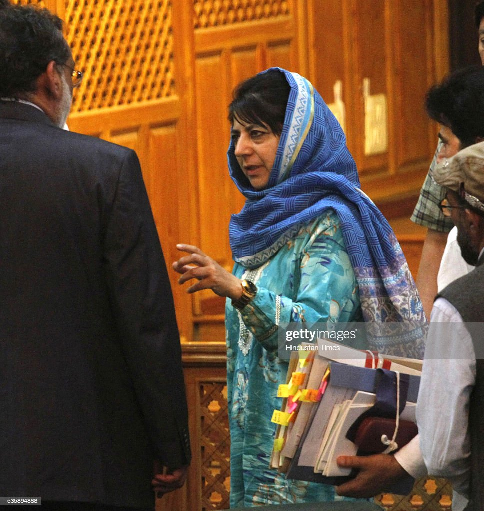 Jammu And Kashmir Chief Minister Mehbooba Mufti talking to Finance Minister Haseeb Drabu after he presents budget 2016-17,during the Budget session on May 30, 2016 in srinagar, India.