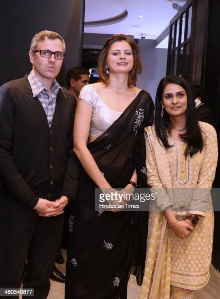 Jammu and Kashmir Chief Minister Omar Abdullah with his sister Sara Pilot at the launch of Nirav Modis boutique on March 22 2014 in New Delhi India