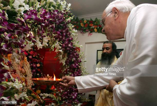 Jammu and Kashmir former chief minister Farooq Abdullah performing Ganesh Pooja at the residence of congress leader of Maharashtra Kripa Shankar...