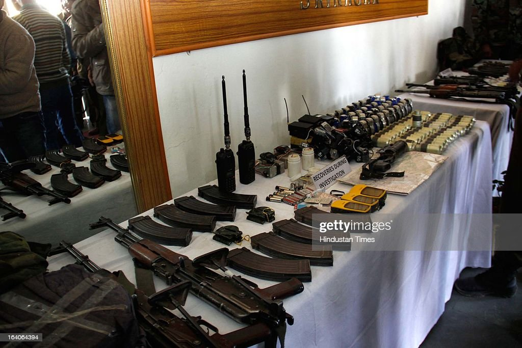 Jammu and Kashmir Police displays arms and ammunition recovered from four persons arrested in connection with fidayeen attack on CRPF Camp at Police Control Room, on March 19, 2013 in Srinagar, India. Claiming to have cracked the case the police said that Investigations had not proved that the attack was a revenge attack for the execution of Guru, who was hanged in Tihar jail on February 9.