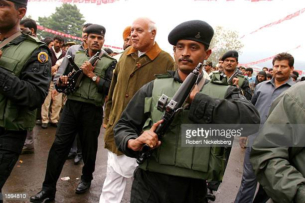 Jammu and Kashmir's Chief Minister and National Conference leader Farooq Abdullah arrives for a campaign rally September 13 2002 in Tangmarg India...