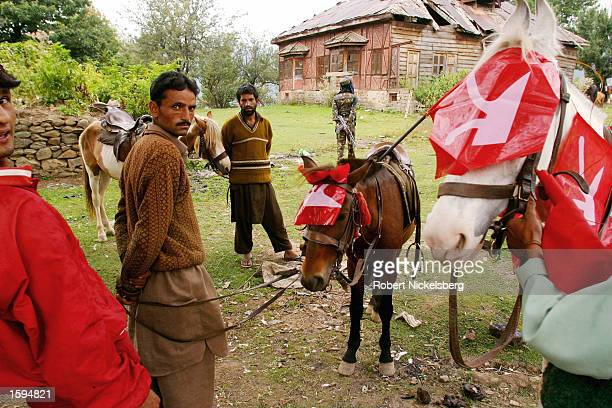 Jammu and Kashmir's Chief Minister and National Conference leader Farooq Abdullah arrives for a campaign rally in Tangmarg September 13 2002 in...