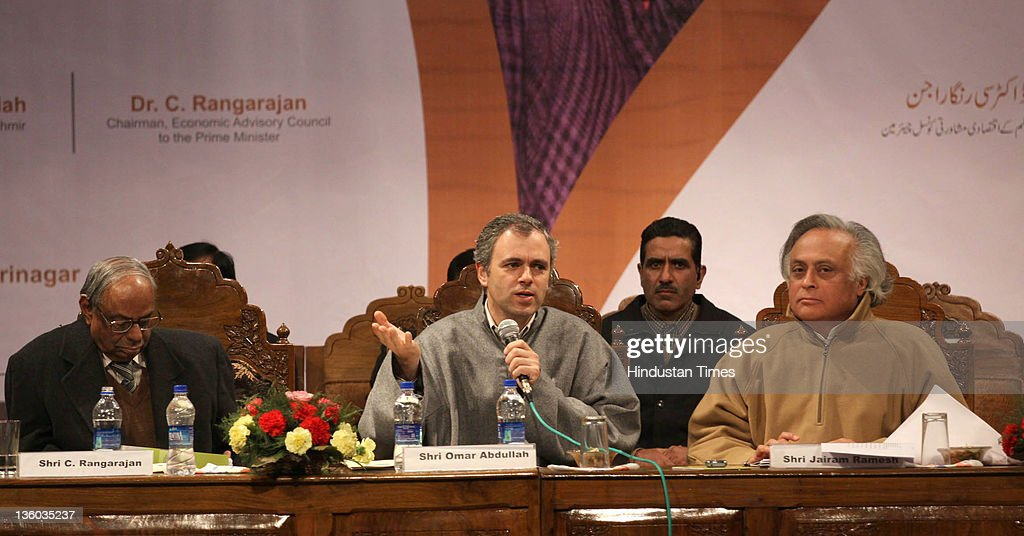 Jammu & Kashmir Chief Minister, Omar Abdullah with Union Rural Development Minister, Jairam Ramesh and C. Rangarajan, chairman, Economic Advisory Council to Prime Minister on stage during a function to distribute appointment letters under Himayat project, launched to provide skill development training to the unemployed youth of Jammu & Kashmir on December 17, 2011 in Srinagar, India.