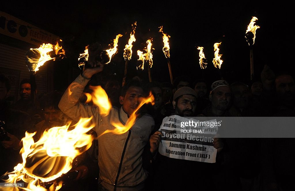 Jammu Kashmir Liberation Front (JKLF) activists hold torches as they shout slogans in Srinagar on April 19, 2014 during a rally against the ongoing Indian general elections. JKLF and several other separatist organisations have jointly appealed to the people of Jammu and Kashmir to boycott Indian parliamentary elections. India's 814-million-strong electorate is voting in the world's biggest election which is set to sweep the Hindu nationalist opposition to power at a time of low growth, anger about corruption and warnings about religious unrest. AFP PHOTO/Rouf BHAT