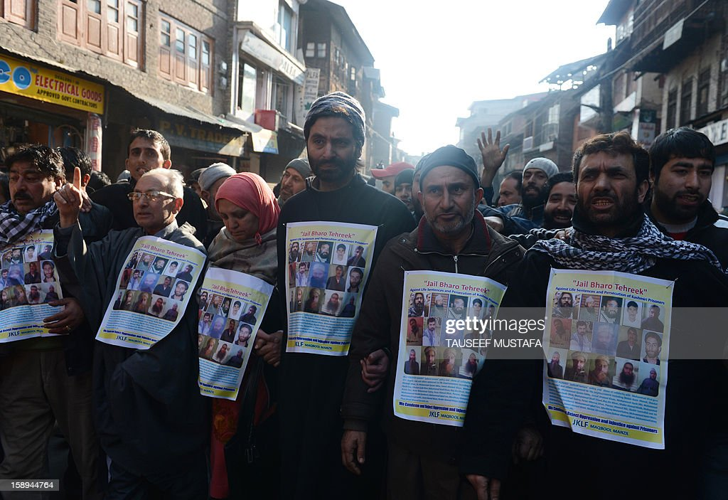Jammu Kashmir Liberation Front (JKLF) chairman Yasin Malik (3rd right) with supporters marches during a protest against a court verdict sentencing two Kashmiris to life imprisonment in Srinagar on January 4, 2013. The Muslim-majority region is in the grip of a 20-year insurgency against rule from New Delhi, which has left more than 47,000 people dead by the official count, a separatists put the toll twice as high. AFP PHOTO/ Tauseef MUSTAFA