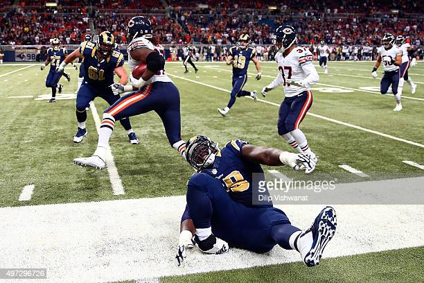 Jamon Brown of the St Louis Rams injures his ankle while making a play in the fourth quarter against the Chicago Bears at the Edward Jones Dome on...