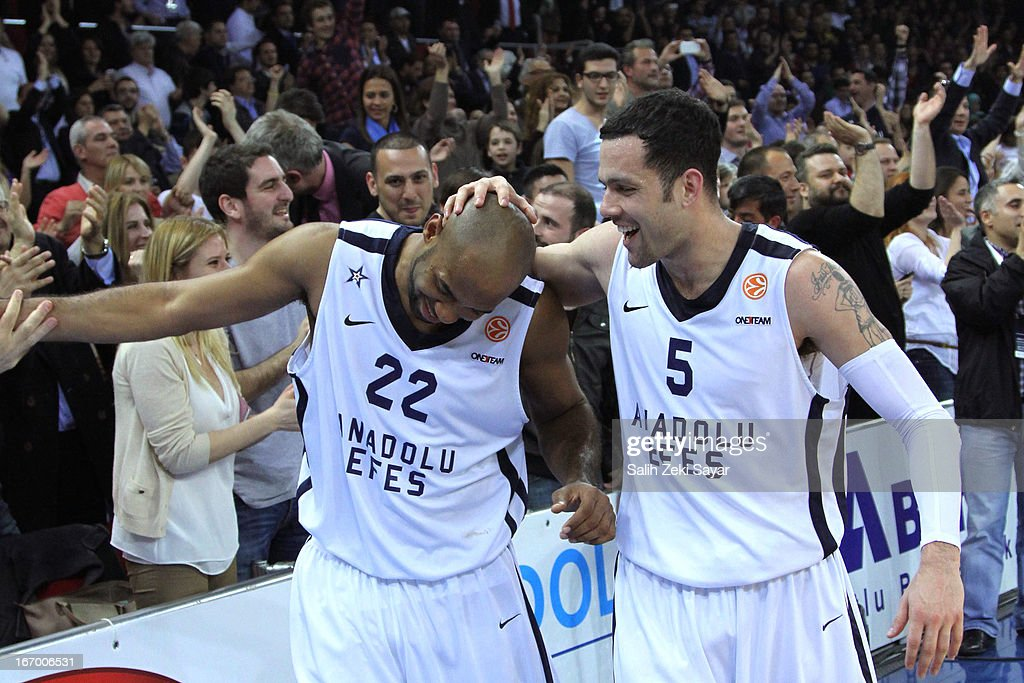 Jamon Lucas #22 and Jordan Farmar #5 of Anadolu Efes celebrate their win after the Turkish Airlines Euroleague 2012-2013 Play Offs game 4 between Anadolu EFES Istanbul v Olympiacos Piraeus at Abdi Ipekci Sports Arena on April 19, 2013 in Istanbul, Turkey.