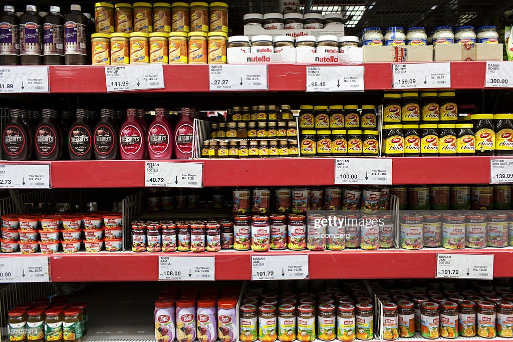 Jams, honeys and syrups sit on display at a Walmart India Pvt. Best Price Modern Wholesale store in the town of Zirakpur on the outskirts of Chandigarh, Punjab, India, on Tuesday, June 10, 2014. India's consumer price index (CPI) figures and wholesale price inflation figures for May are scheduled for release on June 12 and 16 respectively. Photographer: Udit Kulshrestha/Bloomberg via Getty Images