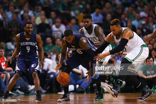 JaMychal Green of the Memphis Grizzlies and Jared Sullinger of the Boston Celtics battle for a loose ball during the third quarter at TD Garden on...