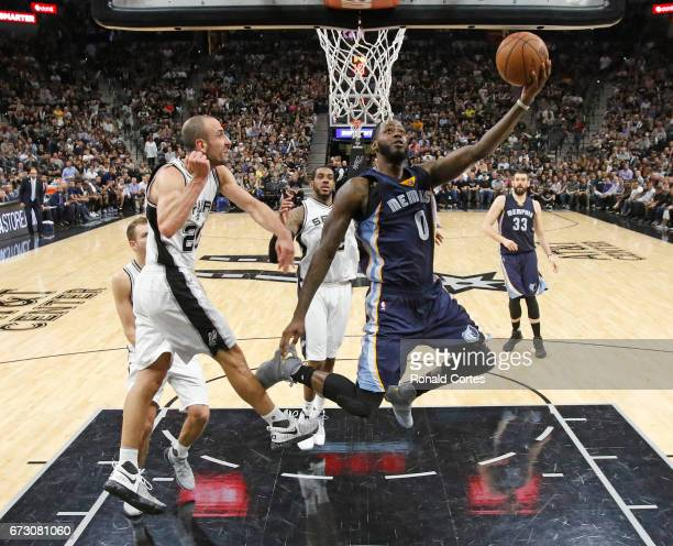 JaMychal Green of the Memphis Grizzlies drives past Manu Ginobili of the San Antonio Spurs in Game Five of the Western Conference Quarterfinals...