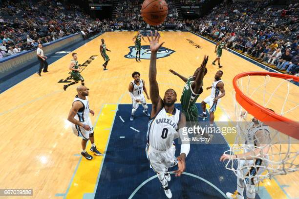 JaMychal Green of the Memphis Grizzlies goes for a rebound during the game against the Milwaukee Bucks on March 13 2017 at FedExForum in Memphis...