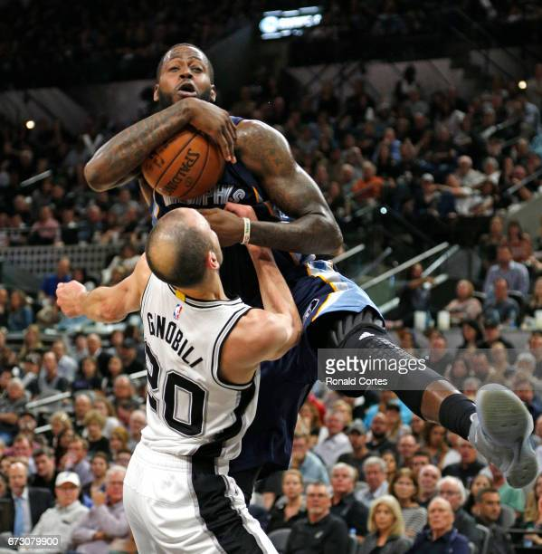 JaMychal Green of the Memphis Grizzlies is tied up by Manu Ginobili of the San Antonio Spurs in Game Five of the Western Conference Quarterfinals...