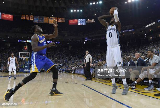 JaMychal Green of the Memphis Grizzlies shoots over Draymond Green of the Golden State Warriors during an NBA basketball game at ORACLE Arena on...