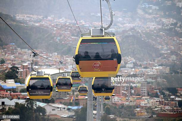 LA PAZ Jan 11 2017 Photo taken on Jan 8 2017 shows the cable cars of yellow line commuting in La Paz capital of Bolivia The aerial cable transport...