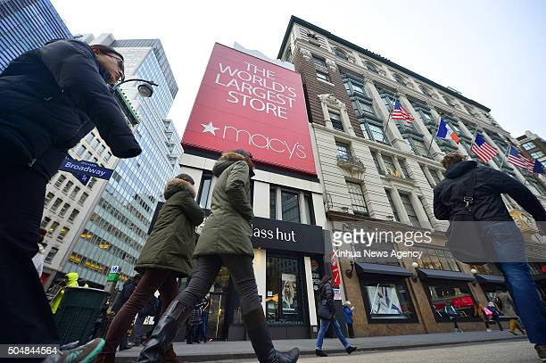 NEW YORK Jan 12 2016 People walk past Macy's flagship store in Manhattan New York the United States on Jan 12 2015 Macy's will cut thousands of jobs...