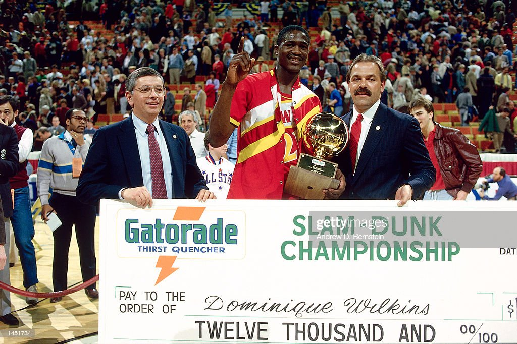 Doninique Wilkins #21 of the Atlanta Hawks poses with David Stern as he receives his check from the sponser of the Slam Dunk Contest during the NBA All Star Weekend in Denver, Colorado.