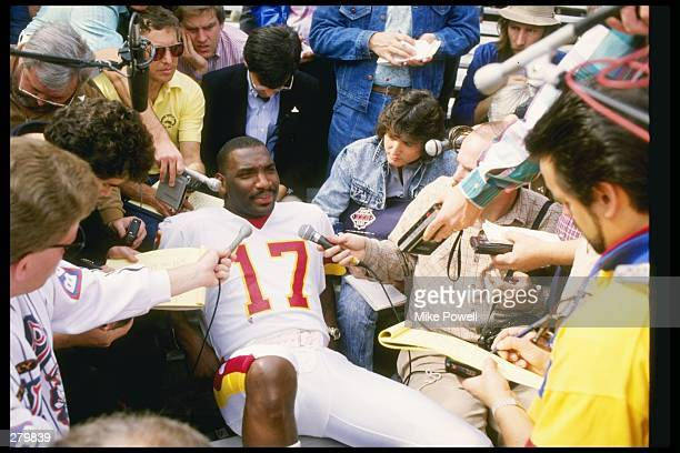 Quarterback Doug Williams of the Washington Redskins fields questions during Media Day for Super Bowl XXII against the Denver Broncos at Jack Murphy...