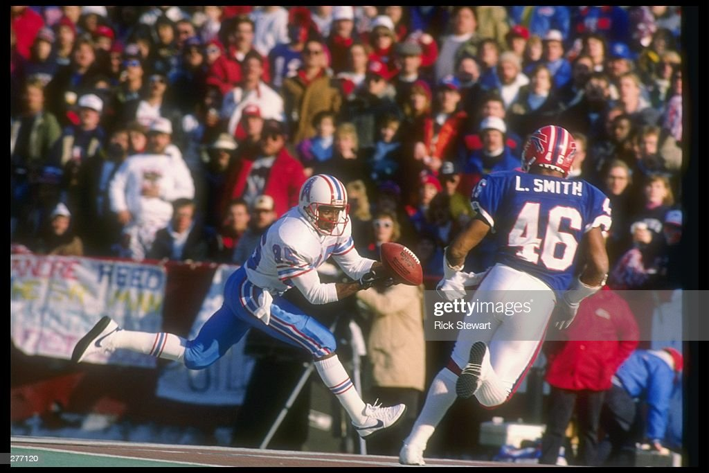 Wide receiver Drew Hill of the Houston Oilers (left) catches the ball as Buffalo Bills defensive back Lonnie Smith closes in during a playoff game at Rich Stadium in Orchard Park, New York. The Bills won the game, 17-10. Mandatory Credit: Ri
