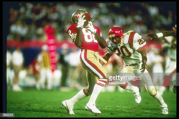 Wide receiver John Taylor of the San Francisco 49ers makes a catch as defensive back Ray Horton of the Cincinnati Bengals moves in during Super Bowl...